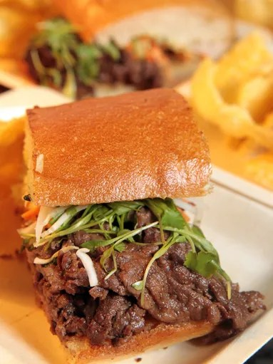 Kobe Beef Banh Mi sandwich with fresh carrots, cilantro,