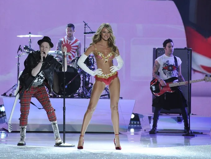 Candice Swanepoel wears the $10 million Fantasy Bra as she walks the runway to a performance by Fall Out Boy.