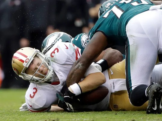 San Francisco 49ers' C.J. Beathard (3) is tackled by Philadelphia Eagles' Brandon Graham, back, during the first half of an NFL football game, Sunday, Oct. 29, 2017, in Philadelphia,. (AP Photo/Michael Perez)