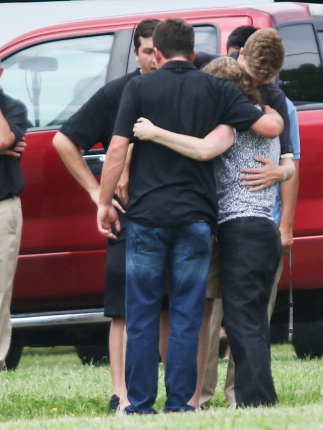 The Vanderbilt baseball team, including coach Tim Corbin (left) visits the family of Donny Everett in Clarksville on June 3, 2016, a day after he drowned in Normandy Lake in Manchester.