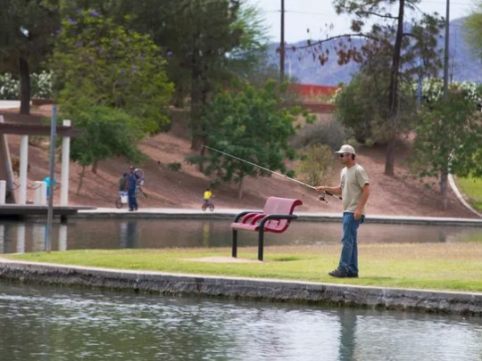 Nathan Foreman, of Queen Creek, fishes at Kiwanis Park
