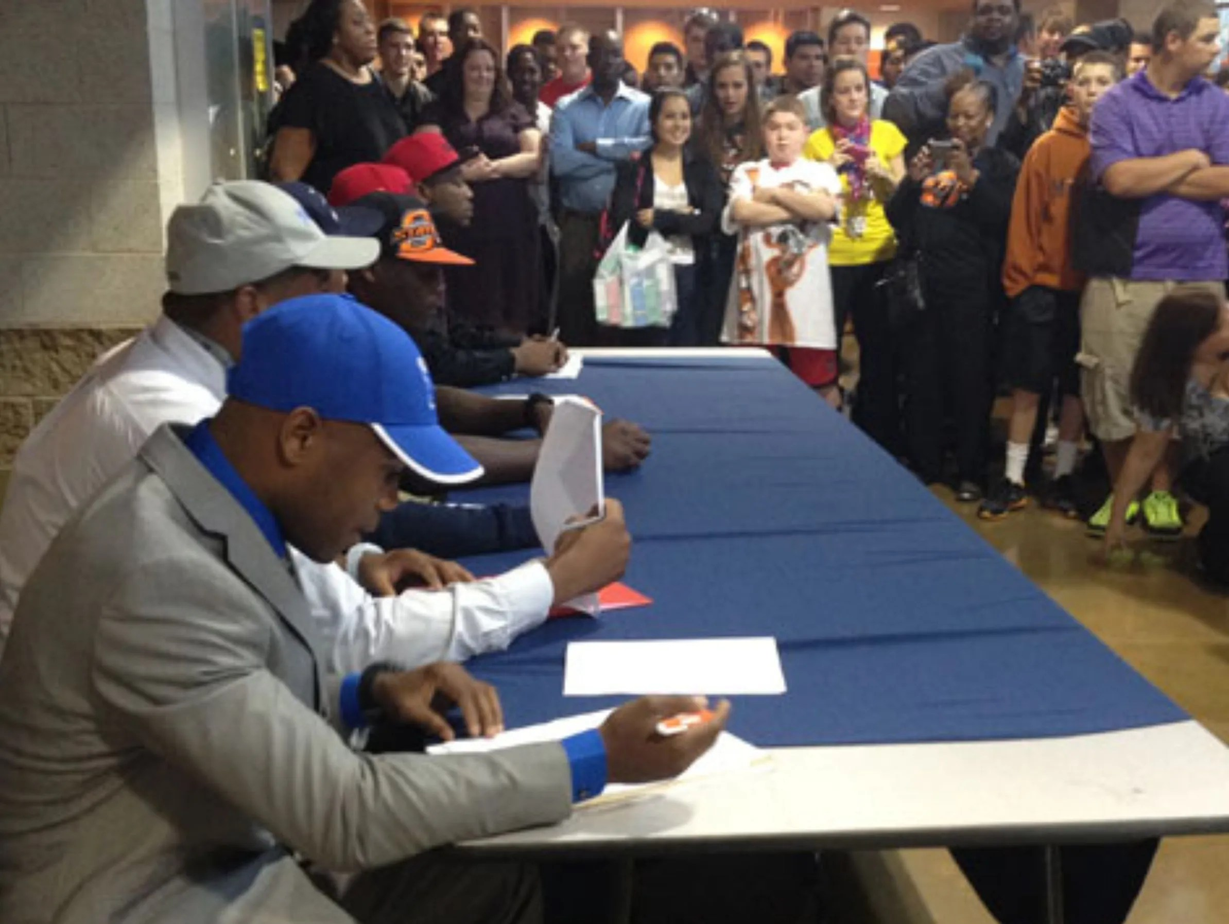 San Antonio high school football players commit to colleges.