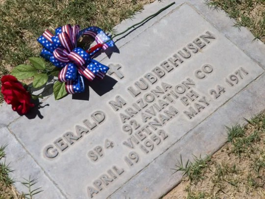 A flower is left at the grave of Spc. Gerald Lubbehusen