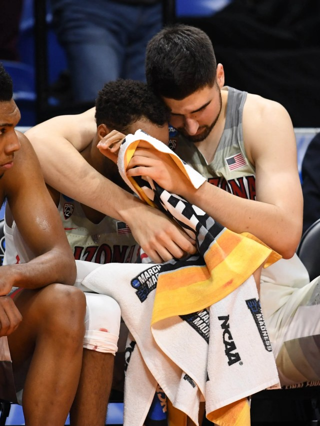 Mar 15, 2018; Boise, ID, USA; Arizona Wildcats guard Allonzo Trier (35), guard Parker Jackson-Cartwright (0), and center Dusan Ristic (14) react on the bench in the second half against the Buffalo Bulls during the first round of the 2018 NCAA Tournament at Taco Bell Arena. Mandatory Credit: Kyle Terada-USA TODAY Sports