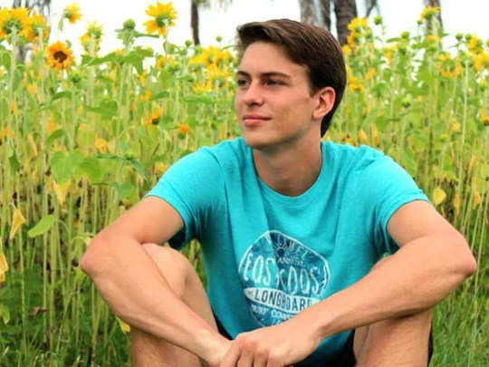 Tristan Schultheis poses in the sunflower field for