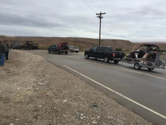 Vehicles pulling off-road recreational vehicles pass