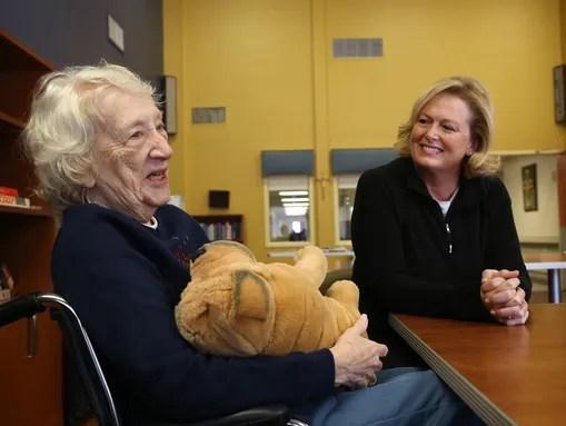 Mischelle Denison, right, of Johnson, Iowa, visits