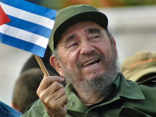 Cuban then President Fidel Castro waving a national