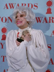 Carol Channing poses with the special Tony Award she