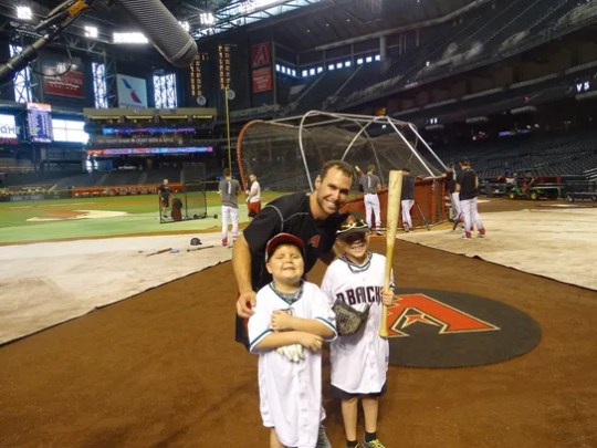 During a trip to Chase Field in 2016, Hollis (left)