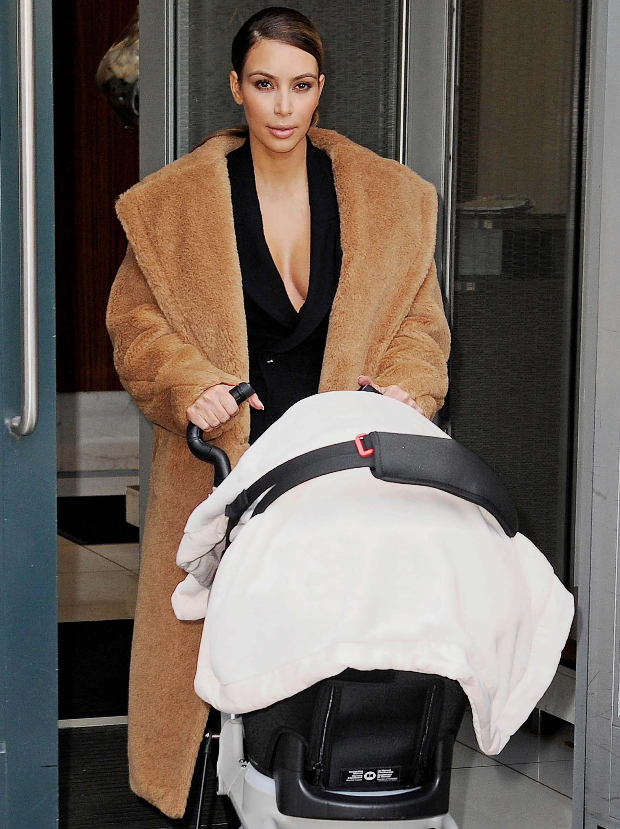 Doing the mom thing: Kardashian pushes baby North in a stroller in Manhattan on Nov. 19, 2013.