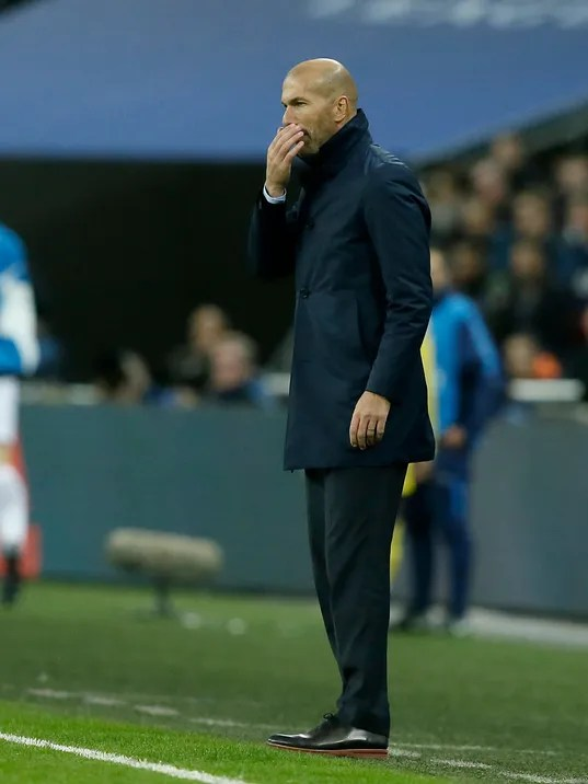 Real Madrid coach Zinedine Zidane stands during a Champions League Group H soccer match between Tottenham Hotspurs and Real Madrid at the Wembley stadium in London, Wednesday, Nov. 1, 2017. (AP Photo/Tim Ireland)