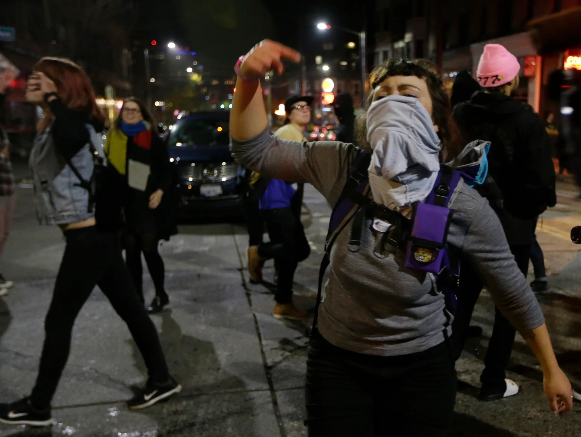 A woman yells as she takes part in a protest against