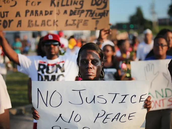 Demonstrators on Tuesday, Aug. 19, protest the killing of teenager Michael Brown  in Ferguson, Mo.