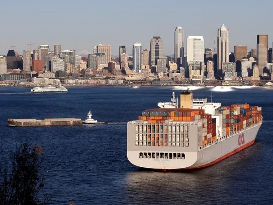 A container ship is moored in Elliott Bay and in view