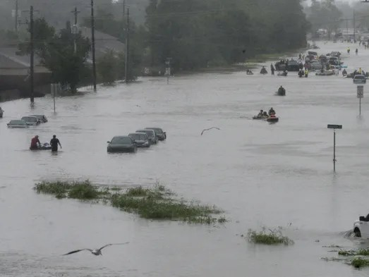 People brave flood waters from Hurricane Harvey  as