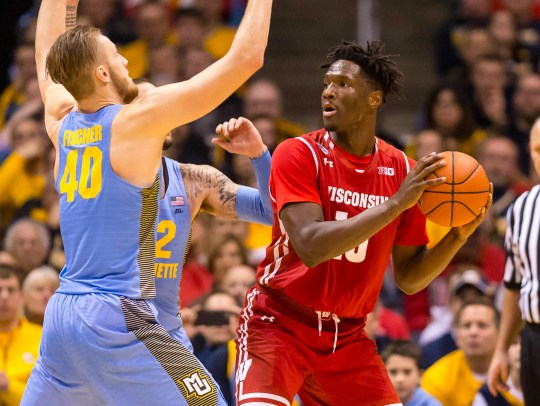 Marquette's Luke Fischer and Wisconsin's Nigel Hayes battle in the rivalry game.