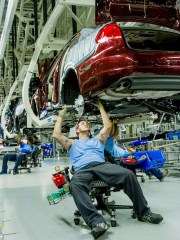 Workers assemble Volkswagen Passat sedans at the German