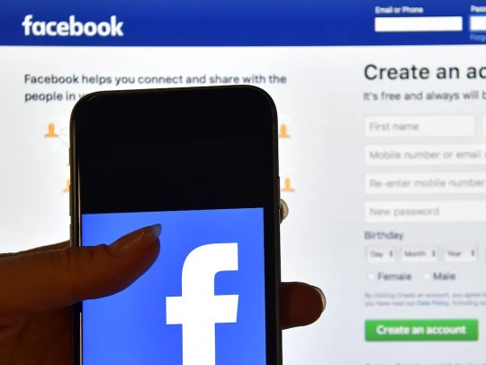 A person uses Facebook on mobile and desktop.
