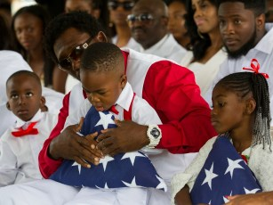La David Johnson Jr., 2, is presented with an American flag that was placed over the casket of his father, Sgt. La David Johnson.