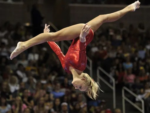 Nastia Liukin hangs in the air as she does a flip on