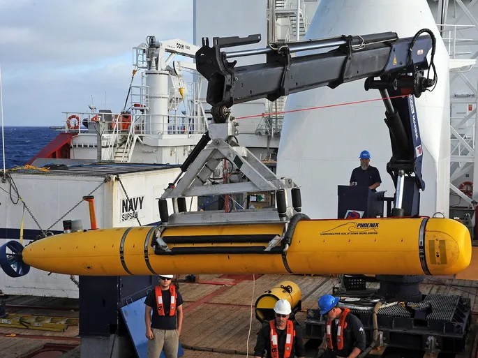 A photograph released on April 15 shows operators aboard the ADF Ocean Shield prepare to launch a U.S. Navy Bluefin-21 robotic submarine to search for the missing Malaysia Airlines jet in the Indian Ocean.