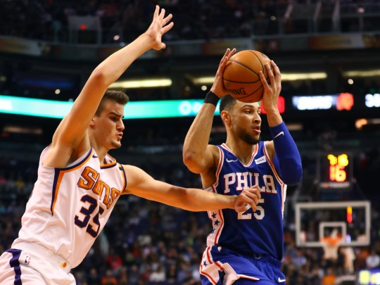 Ben Simmons of the 76ers works against Dragan Bender of the Suns during the first half of a game on Dec. 31 at Talking Stick Resort Arena.
