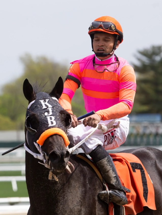 Albin Jimenez rides Ark in the Dark to the winners circle after the first race of the day. Opening Day of Horseracing at Monmouth Park brought out the crowds and celebrators since it's also Kentucky Derby Day.
