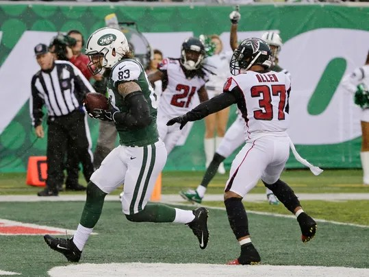 New York Jets tight end Eric Tomlinson (83) runs past Atlanta Falcons Ricardo Allen (37) for a touchdown during the first half of an NFL football game Sunday, Oct. 29, 2017, in East Rutherford, N.J. (AP Photo/Seth Wenig)