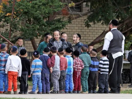Young boys line up outside a yeshiva in New Square.