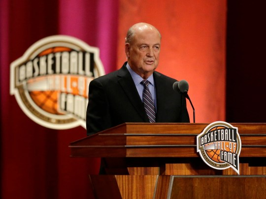 NCAA adminstrator Tom Jernstedt speaks during his enshrinement into the Naismith Memorial Basketball Hall of Fame on Friday, Sept. 8, 2017, in Springfield, Mass. (AP Photo/Stephan Savoia)