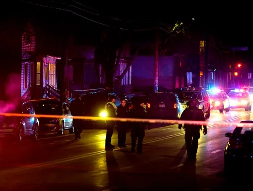 Madison Police investigate the scene of a shooting