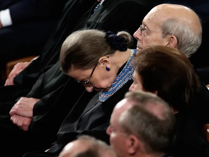 Supreme Court Justice Ruth Bader Ginsburg sits among the other justices during President Obama's address.
