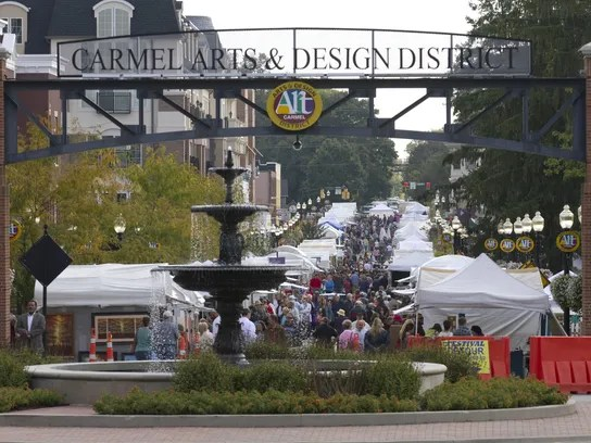 Festival goers walk around the Carmel International