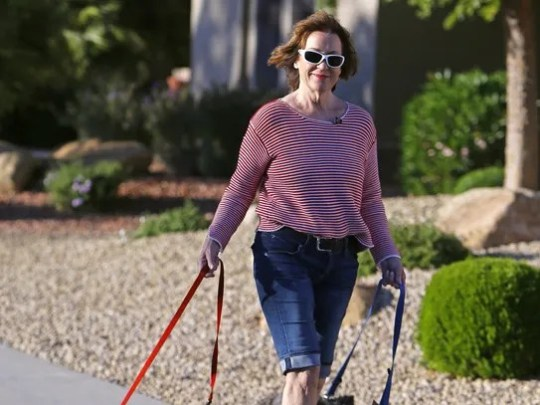 Marilyn McLauchlan walks her dogs  March 16, 2016,