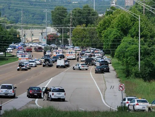 Police and emergency vehicles block Amnicola Highway