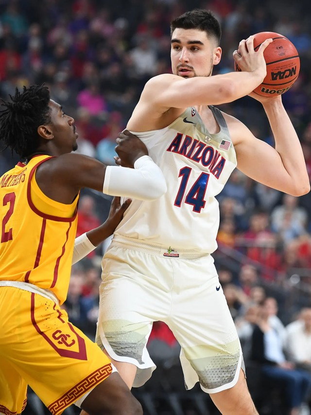Mar 10, 2018; Las Vegas, NV, USA; Arizona Wildcats center Dusan Ristic (14) protects the ball against USC Trojans guard Jonah Mathews (2) during the Pac-12 Tournament championship at T-Mobile Arena. Mandatory Credit: Stephen R. Sylvanie-USA TODAY Sports