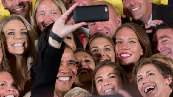 President Obama poses for a selfie with the U.S. Women's