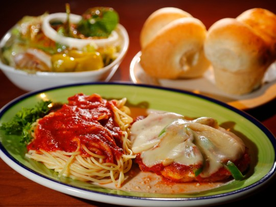 The Chicken Parmesan meal with spaghetti, salad, and