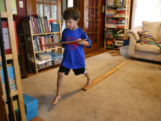 Schuyler Peck, 5, does some balance exercises to help