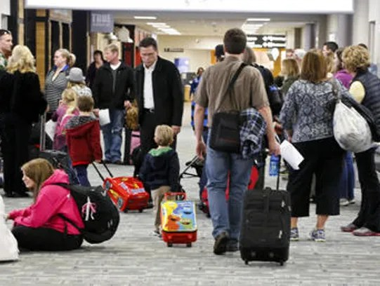 A terminal filled with fliers at the Des Moines International