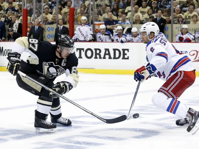 Pittsburgh Penguins center Sidney Crosby (87) skates with the puck as New York Rangers defenseman Anton Stralman (6) defends during the third period in game one.