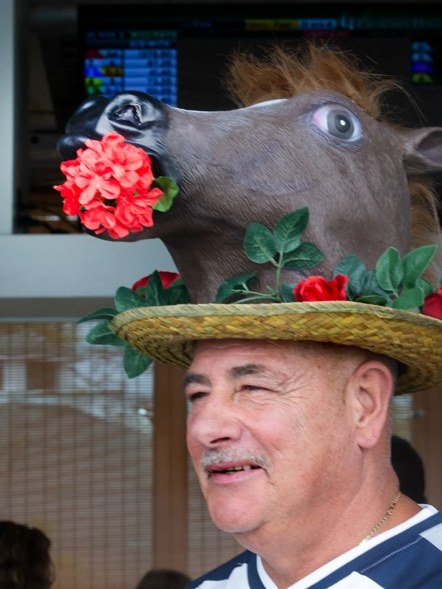 Frank Anello of Wall wears a horse hat on Opening Day of Horseracing at Monmouth Park brought out the crowds and celebrators since it's also Kentucky Derby Day.