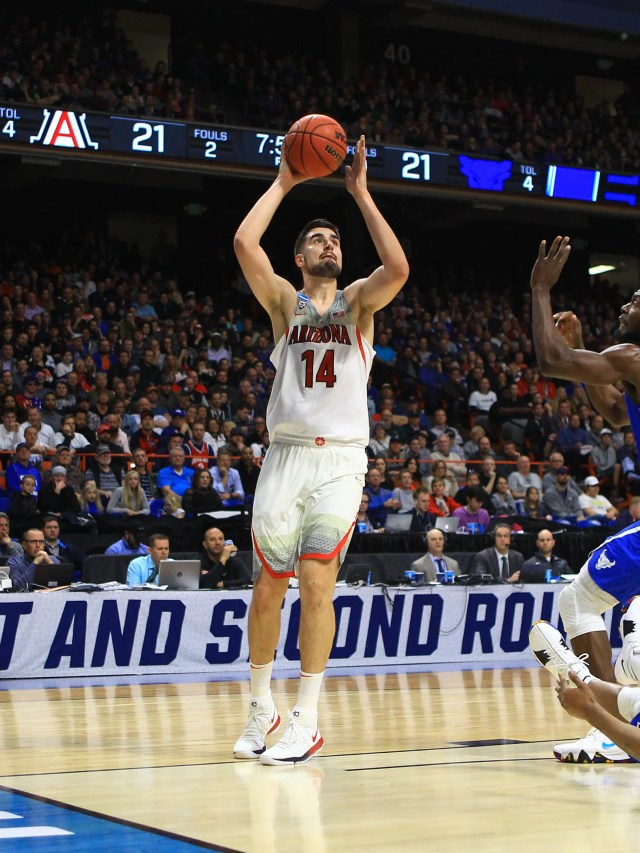 Mar 15, 2018; Boise, ID, USA; Arizona Wildcats center Dusan Ristic (14) looks to shoot as Buffalo Bulls guard Davonta Jordan (4) falls to the floor in the first half during the first round of the 2018 NCAA Tournament at Taco Bell Arena. Mandatory Credit: Brian Losness-USA TODAY Sports