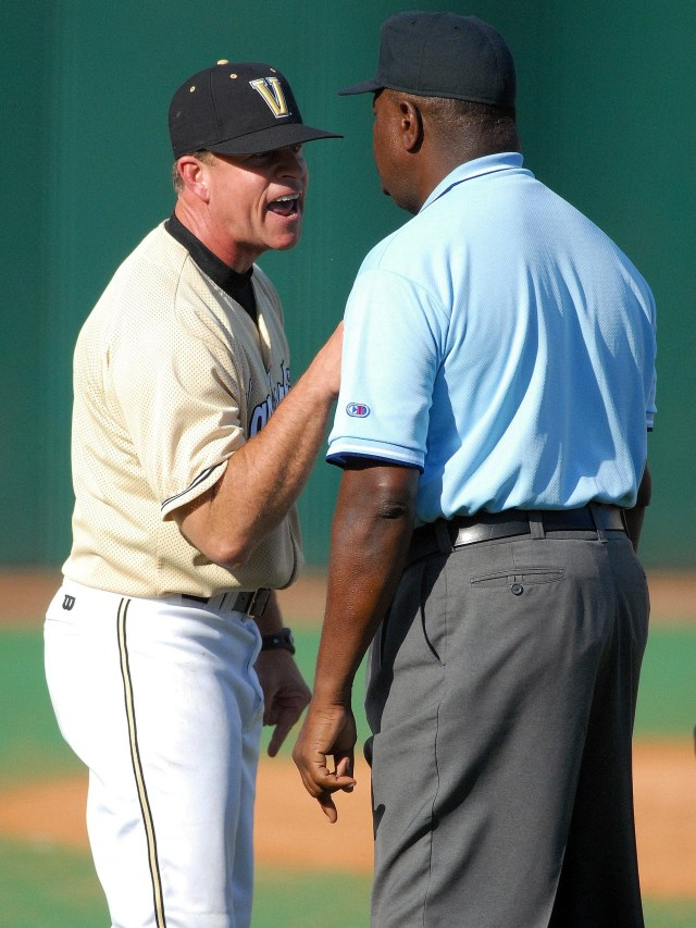 Tim Corbin argues with first base umpire Al Davis after Vanderbilt's game against Alabama ended on an interference call at second base on April 23, 2006.