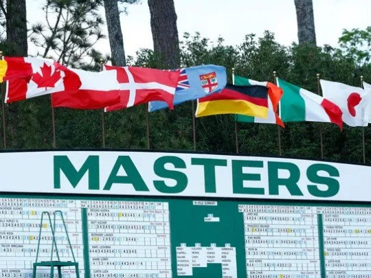 Flags fly in the wind atop the main leaderboard during