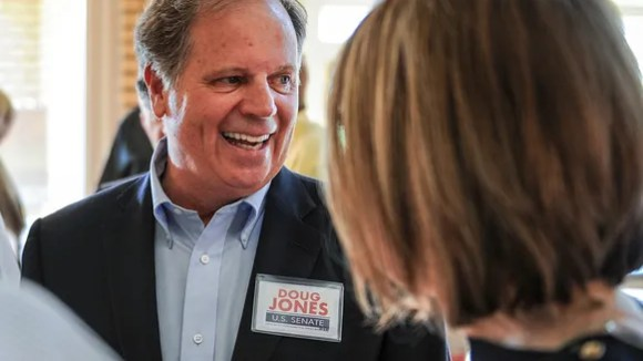 In this Aug. 3, 2017, file photo, Doug Jones chats