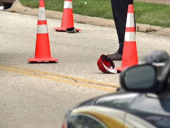 A hat lays at the scene where Michael Brown was shot to death Saturday.