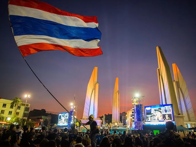 Anti-government protesters rally at the Democracy Monument on Nov. 27 in Bangkok, Thailand. Prime Minister Yingluck Shinawatra has enacted a special security law to counter demonstrators who stormed into government buildings during a mass protests against her rule.