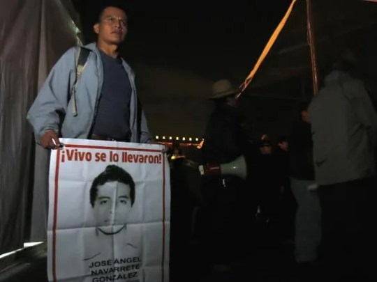 A sign bearing the picture of missing Jose Angel Navarrete.